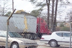 The truck trailer split in half by CSX 238 and CSX 159