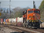 BNSF 6075 25th Anniversary stickers brings up the rear