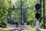 Bicyclist crossing ex-B&O connecting track. PRR signals control interlocking