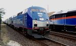 John Kerry tour locomotive meets Metra MP36