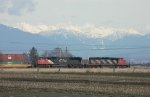 CN 5628 and 5301 pose in front of the mountains