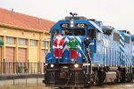 Texas Pacifico Begins to pull into San Angelo Station with Santa, Elf, and Photographer on the nose!