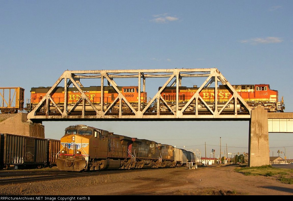 BNSF 5266 and 9969 roll over UP 6032