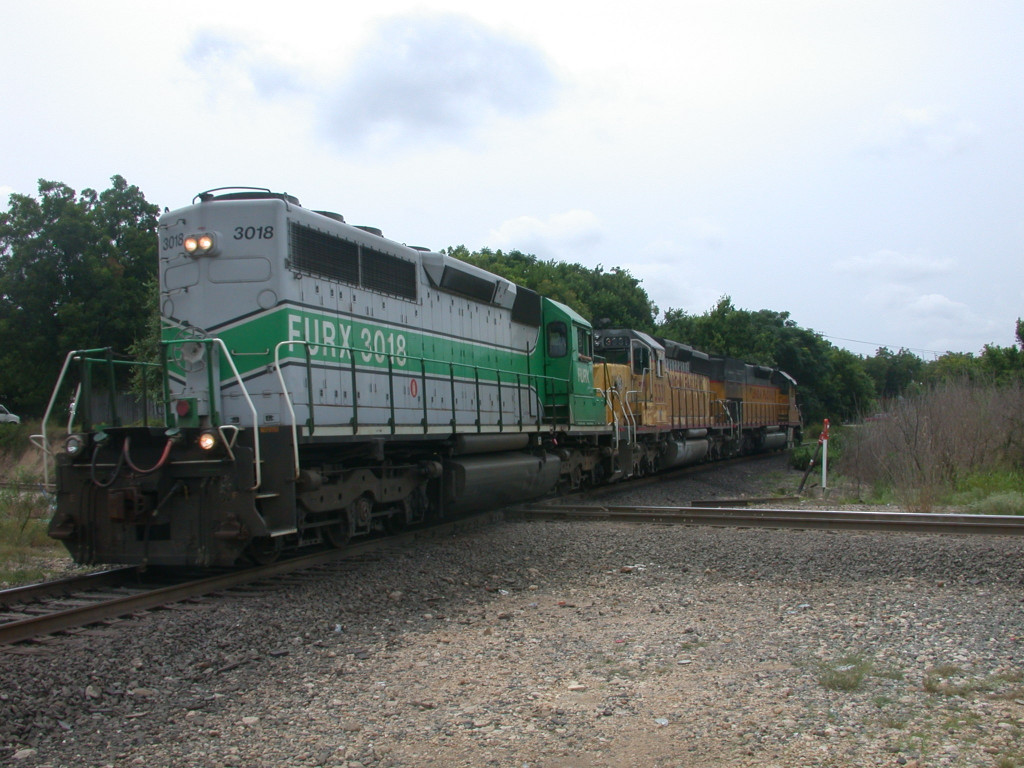 FURX 3018  22Aug2004  NB on the old MKT rails across the diamond at mp 227
