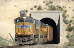 UP 4586 West pops out of a tunnel