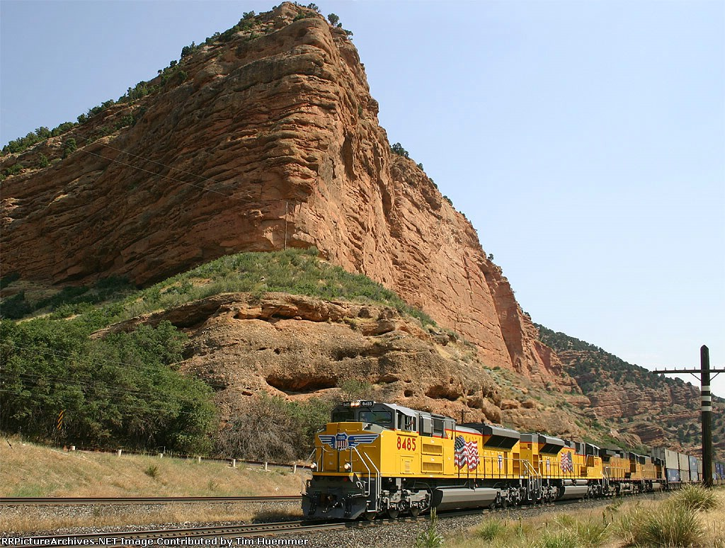 Brand new ACe's lead a westbound stack train