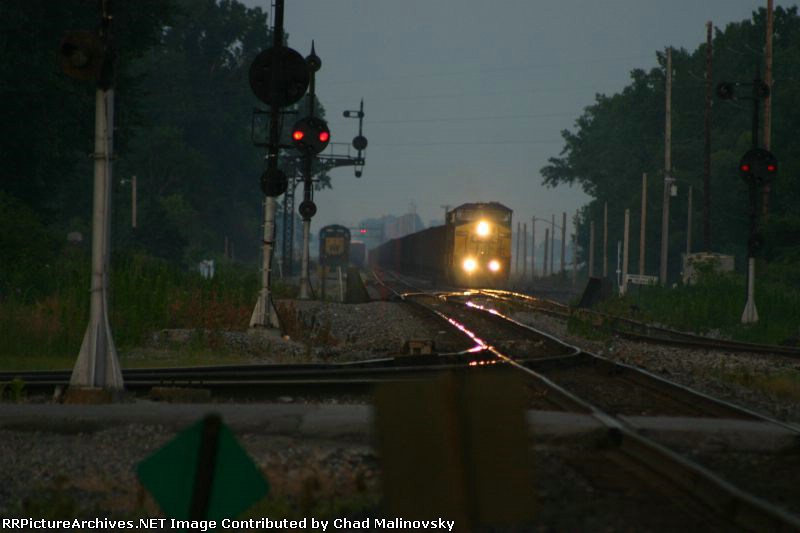 Perfectly executed 3 train meet.  CSX 7705 takes empties back to the docks for more taconite