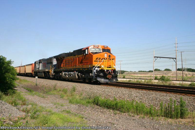 BNSF 5984 has DEEX empties in tow