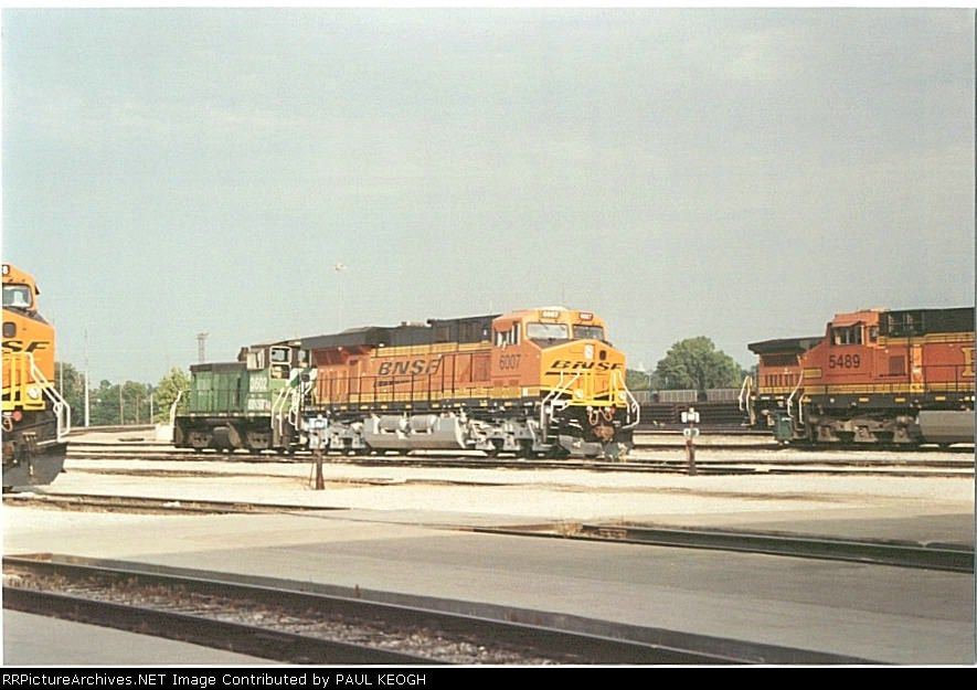 BNSF 6007 sits in the BNSF Lincoln Mechanical yard awaiting a new engine