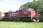 CP 9777 waits on an auto train for its turn