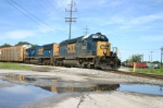 CSX 8480 bring new Ford trucks onto the Harbor Belt