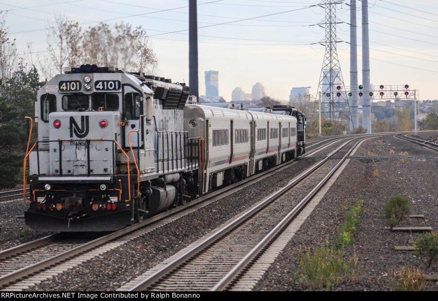 The trailing enmd of train 1630 with another former CNJ Geep on the west end as it heads for Hoboken