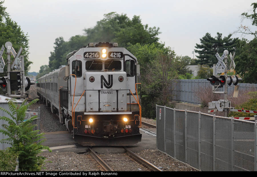 NJT 4216 rolls west with an express on a sultry summer afternoon