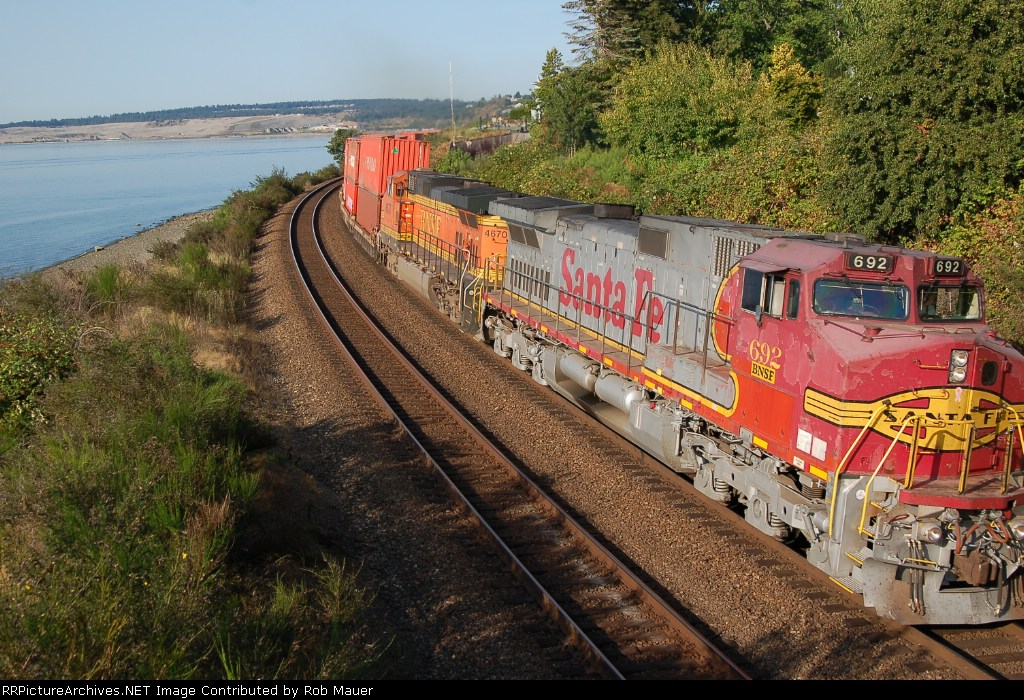 BNSF 692 leads double stack south on opposite main.
