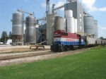 The HESR 820 job passes the grain elevator