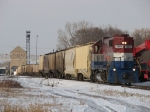 3865 pulls its long grain train out of the east yard as LSRC 469 sits in the distance awaiting its fate