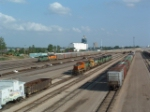 BNSF 7808 rolls by stored power at the south end of Northtown yard
