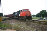 CN 5631 heads west as Man stands in truck