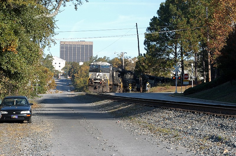 early sunday morning and csx runs a military train on to the sims block east out of town with a single unit