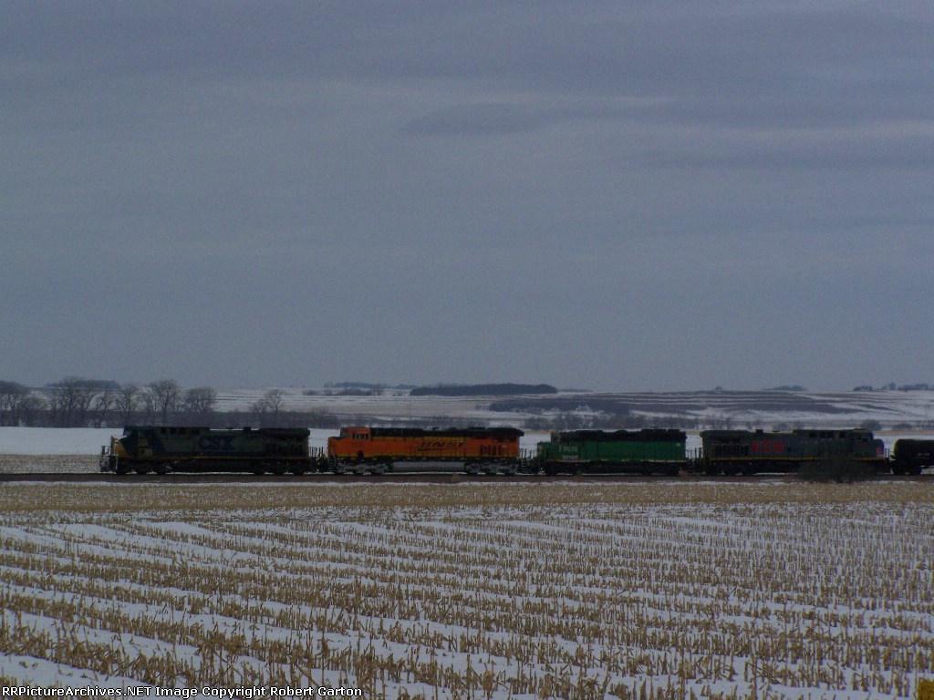 CSX 130, BNSF 7535, BNSF 3015 & KCSM 4508 Lead Mixed Freight