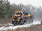 Rolling north over snow covered rails, 3001 heads through the forests