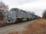 GLLX 3002 with its train stretched out behind it