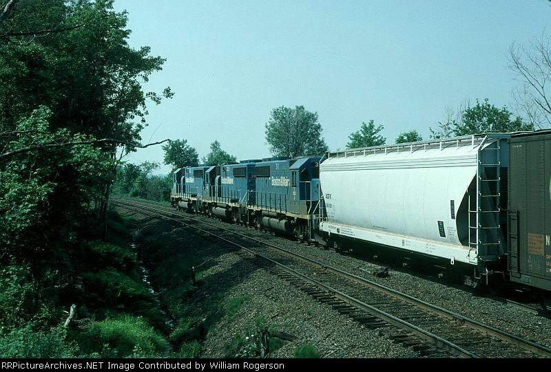 """Eastbound Boston and Maine Mixed Freight Train """"ML2"""", with EMD GP40-2 No. 301 in the lead,"""