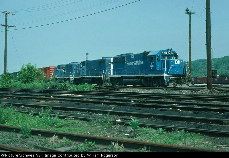"""Eastbound Boston and Maine Mixed Freight Train """"NE2"""", with EMD GP40-2 No. 308 in the lead,"""
