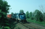 "Westbound Boston and Maine Mixed Freight Train ""AP3"", with EMD GP40-2 No. 310 in the lead,"