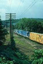 "Boston and Maine Railroad Mixed Freight Train ""EDME"", with three EMD GP38-2's providing power,"