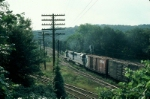 "Going away shot of Boston and Maine Railroad Mixed Freight Train ""BOSE"", with two EMD GP40-2's providing power,"