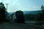 """Westbound Boston and Maine Railroad Mixed Freight Train """"POSE"""", with EMD GP40-2 No. 307 in the lead,"""
