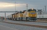 UP 8446 East departs Centennial Yard