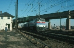 Southbound Amtrak Passenger Train with GE E60 No. 957 in the lead passes Hunter Tower