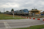 """Northbound Amtrak Train No. 98, the """"Silver Meteor"""", with GE P42DC """"Genesis"""" Locomotive No. 166 in the lead,"""