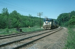 Westbound Delaware & Hudson Railway (DH) Mixed Freight Train led by EMD GP39-2 No. 7610