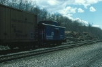 Conrail Caboose No. 23560 brings up the rear of a mixed freight train