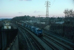 """Southbound Conrail Mixed Freight Train """"SELI"""", with GE B23-7 No. 2807 in the lead,"""