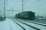 Going away shot of Southbound Conrail Diesel Power, with GE B23-7 No. 1916 in the lead,