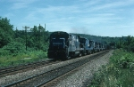 """Northbound Conrail (CR) Mixed Freight Train """"OPSE"""" with GE B23-7 No. 2807 in the lead"""