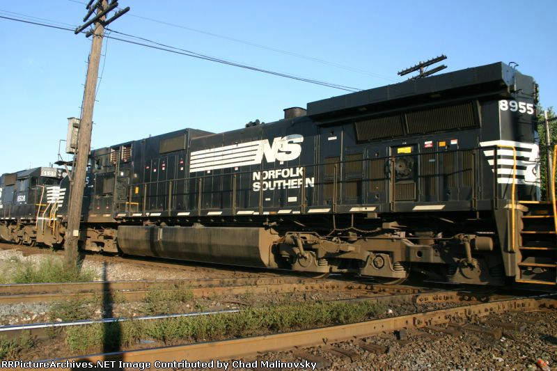 NS 8955 hides behind the line pole