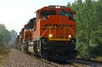 BNSF 9396, EMD SD70ACe, leads westbound coal empties