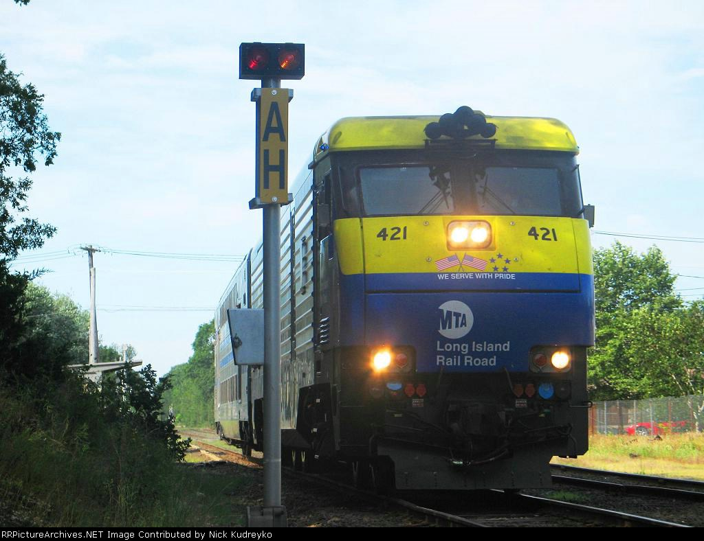 LIRR Train 200 heads east through the AH Block limit signal