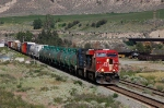 Westbound CP Rail (Canadian Pacific Limited - CP) Mixed Freight Train led by GE ES44AC No. 8743