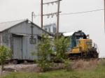 CSX 6122 peeks out from around a building