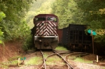 134 waits with a cut of coal loads south of the wye