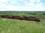 BNSF 7657 Creeps Past With a Manifest Train