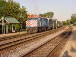 An Eastbound Metra train makes at stop at