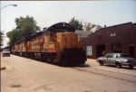 Three former Chessie/C&O SD18s lead a coal train northward on street trackage