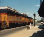Three former Chessie/C&O SD18s lead a coal train on street trackage